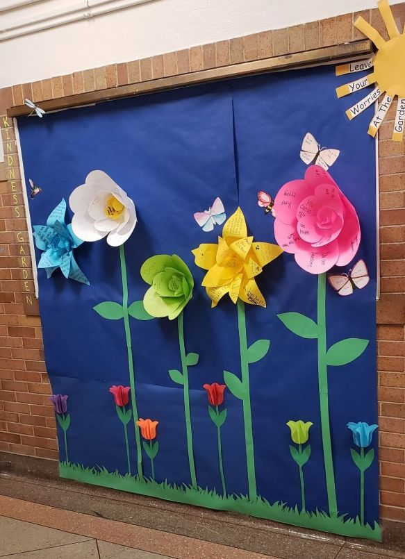 Bulletin board depicting a floral scene.