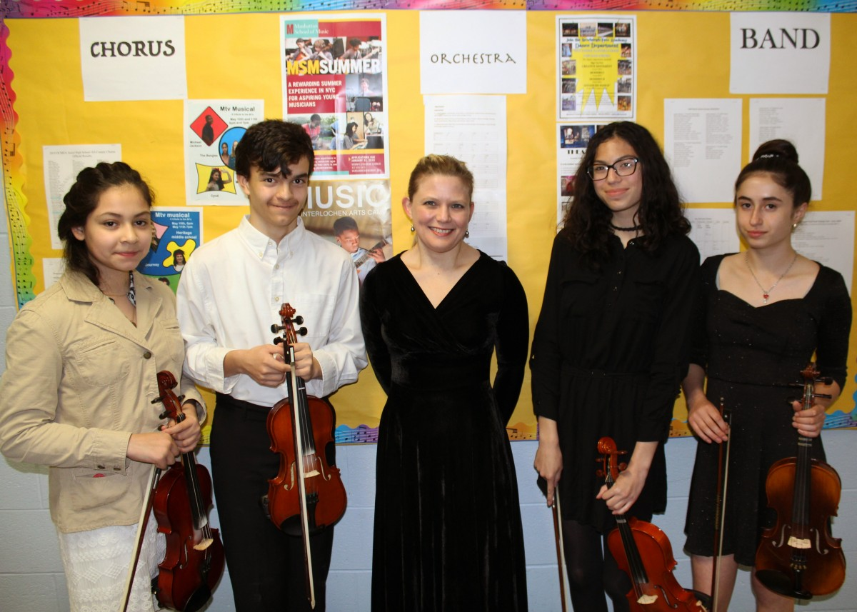 The Eighth Grade Select Orchestra Group. (From L to R) Emily Palacios, David Peterson, Ms. Allen, Isabella Delgado and Sarah Murphy.
