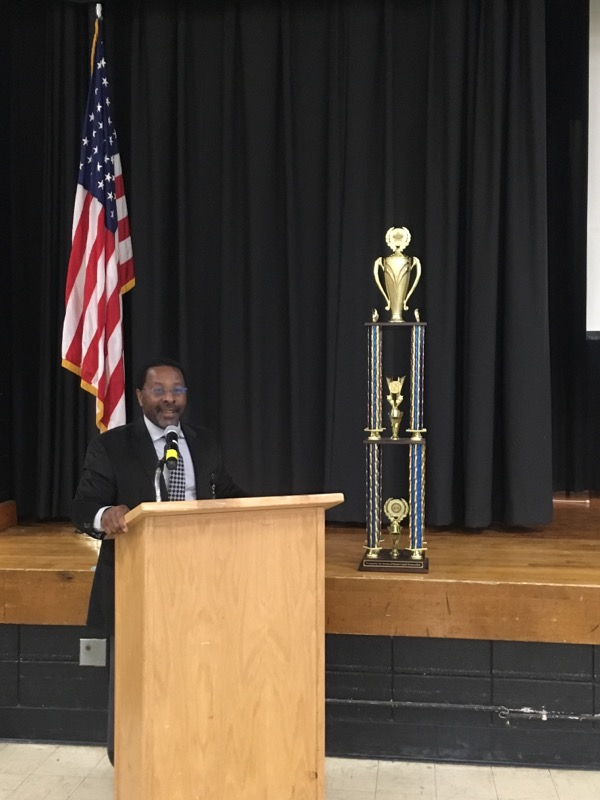 Assistant Superintendent for Human Resources, Mr. Michael McLymore presents the trophy