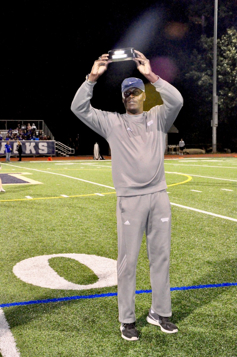 Coach Malcolm Burks honored as Boy's Track and Field Coach of the Year at a football game