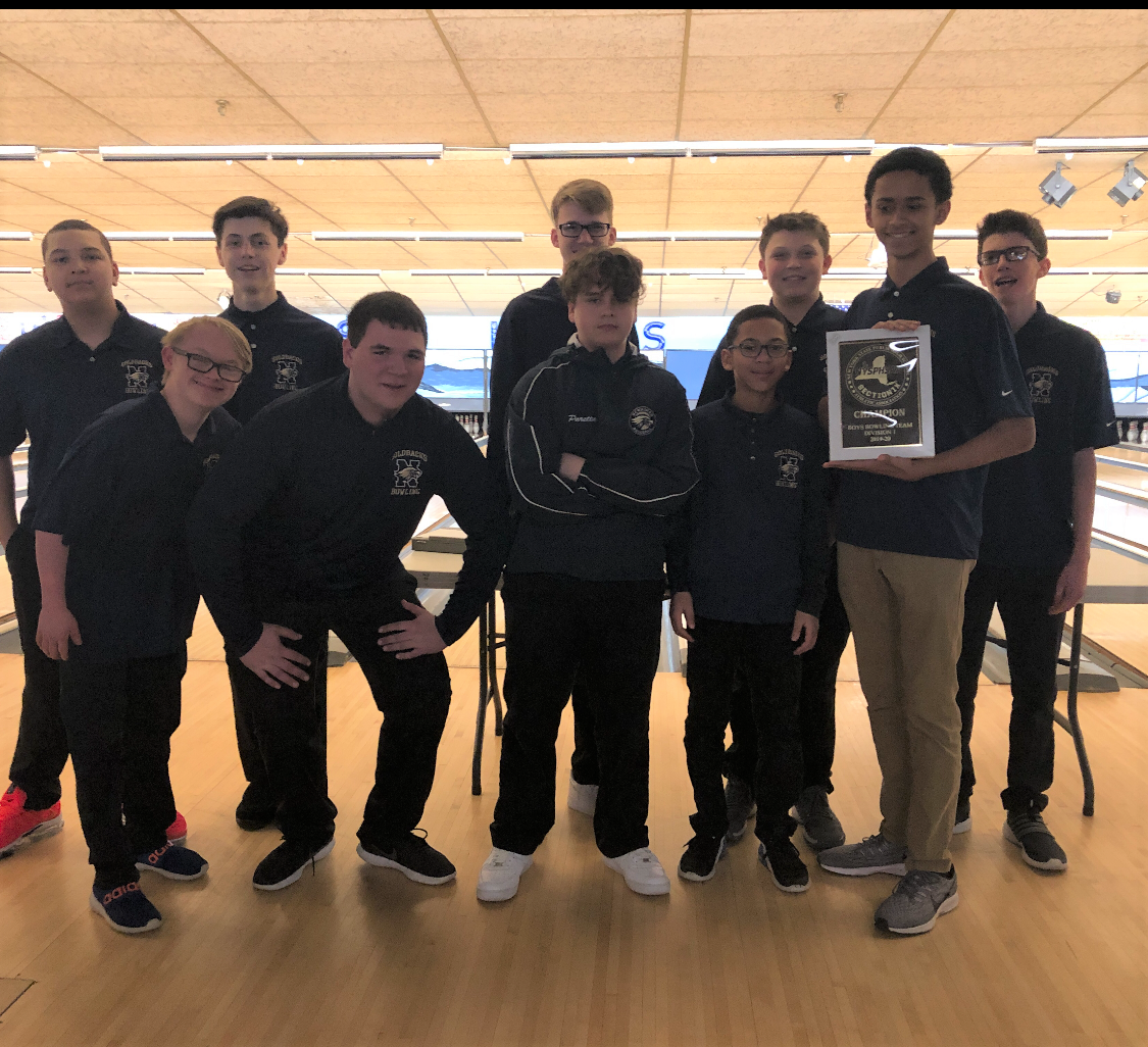 The NFA Boys Varsity Bowling Team poses for a photo with their plaque.