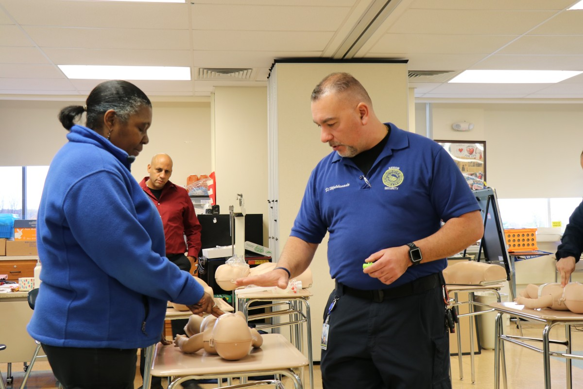 Senior school monitor, Mr. David Maldonado instructs security guards on technique.