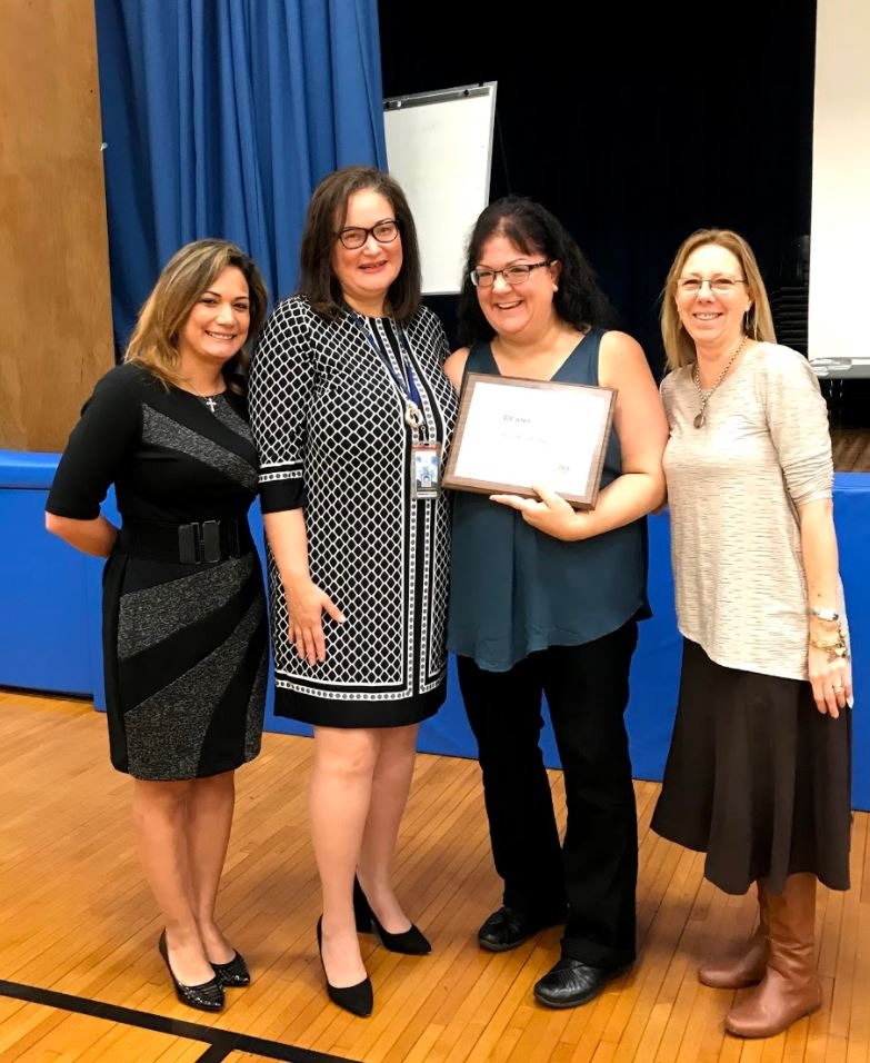 Assistant Superintendent Mrs. Sara Feliz, awarded Mrs. Muller with the Big Heart Award. Along with Dr. Spindler & Mrs. Lamarche.