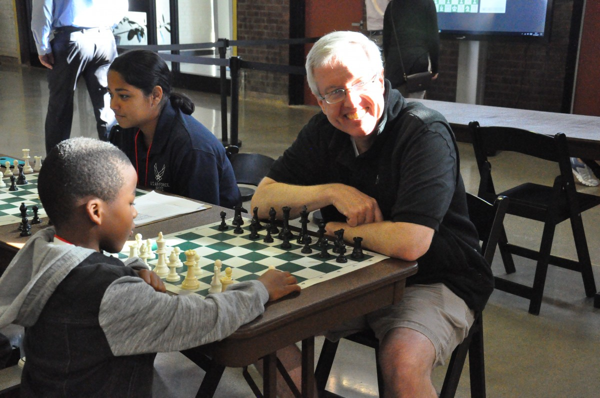Board member, Mr. Johnston plays chess at Newburgh Armory