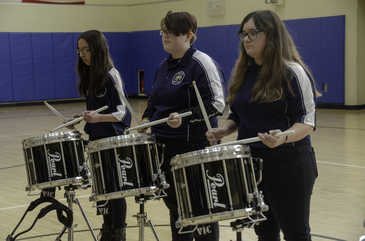 Students performing in the Drumline.