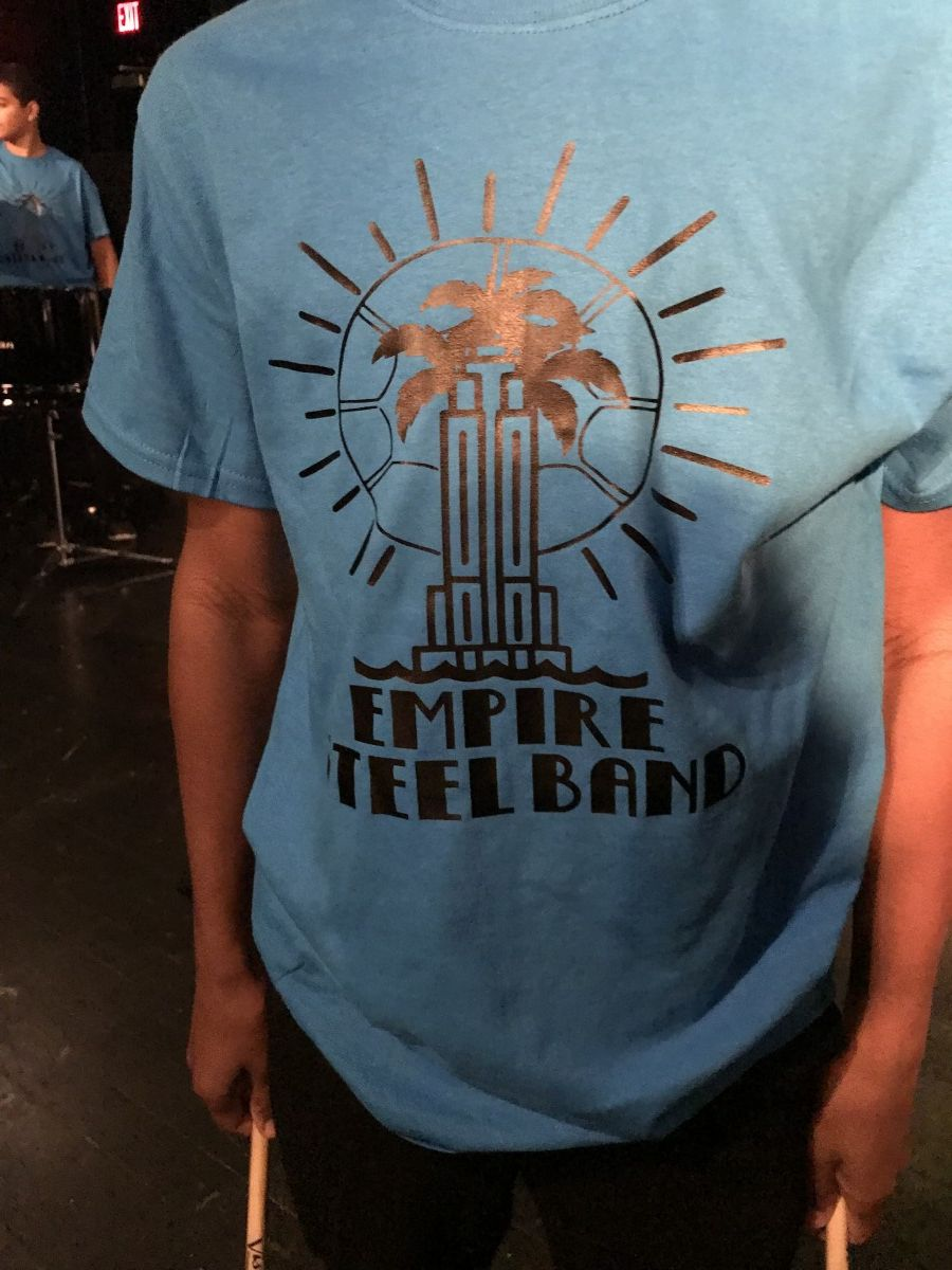 T-shirt worn by the group.