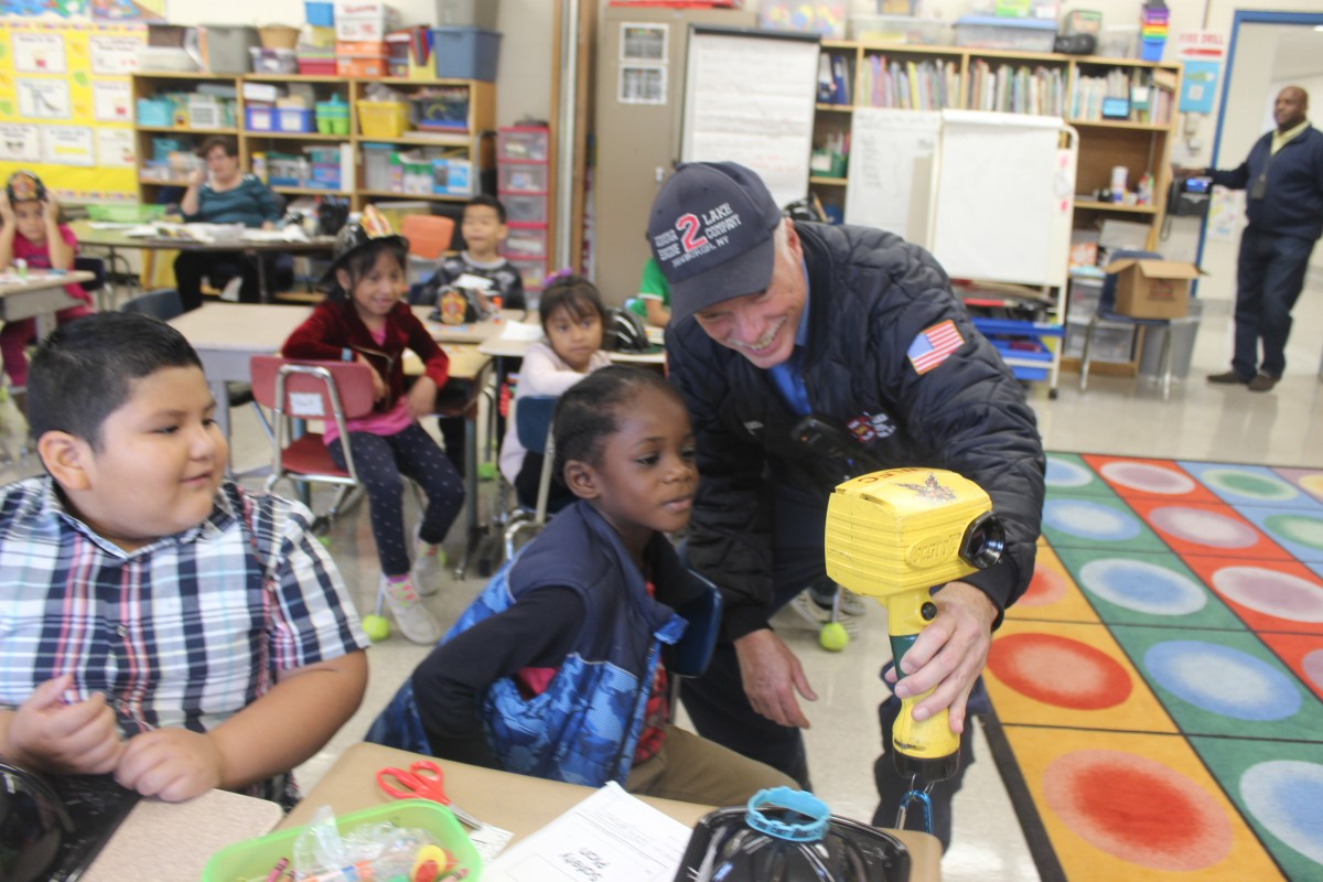 Students learn from a firefighter.