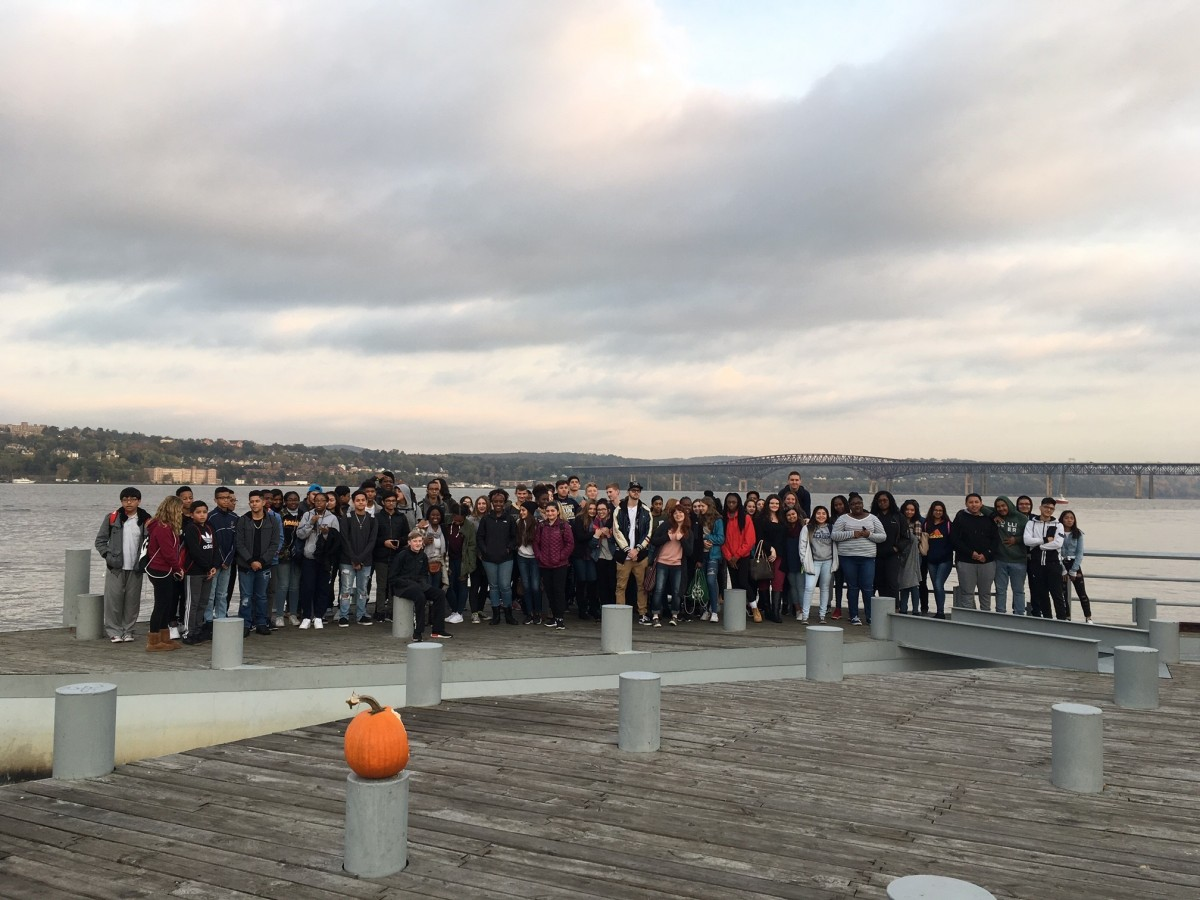 83 NFA Students pose at Beacon's Long Dock with Newburgh positioned behind them