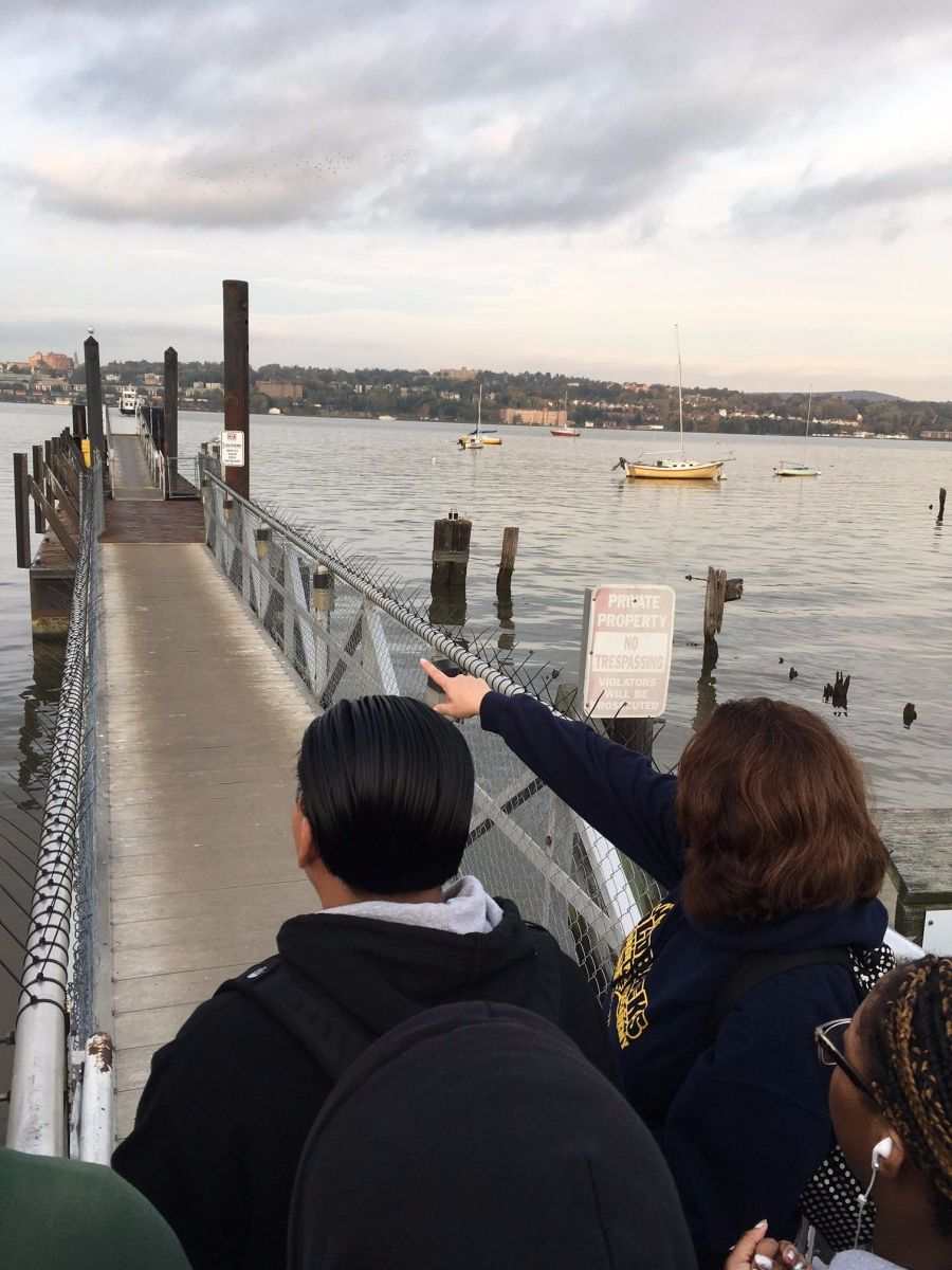Mrs. Sileno points to incoming ferry