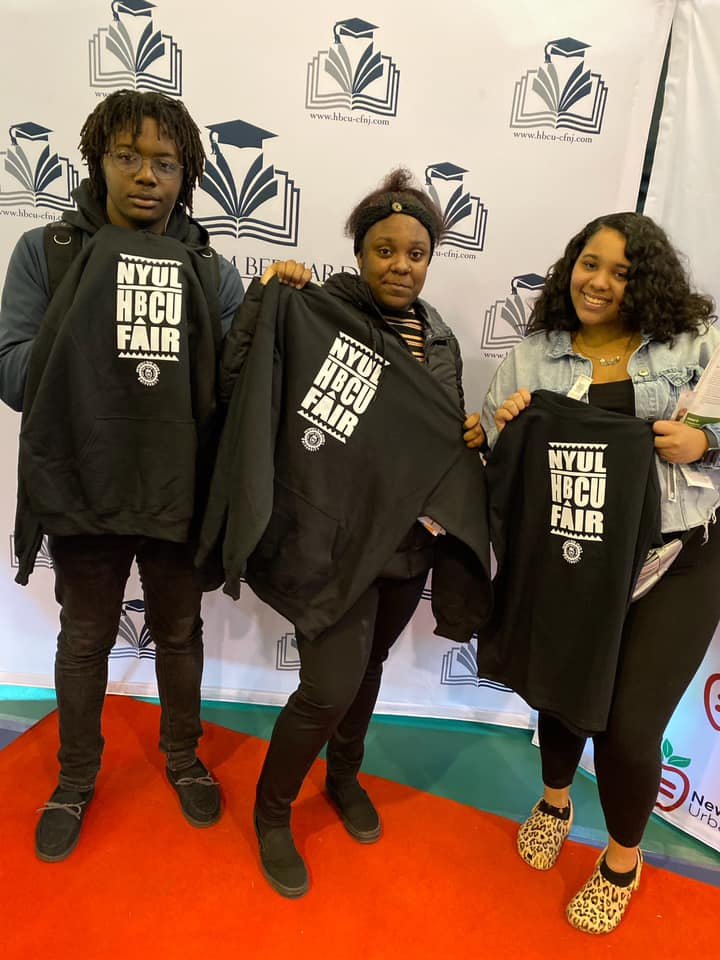 Students pose with fair t-shirts.