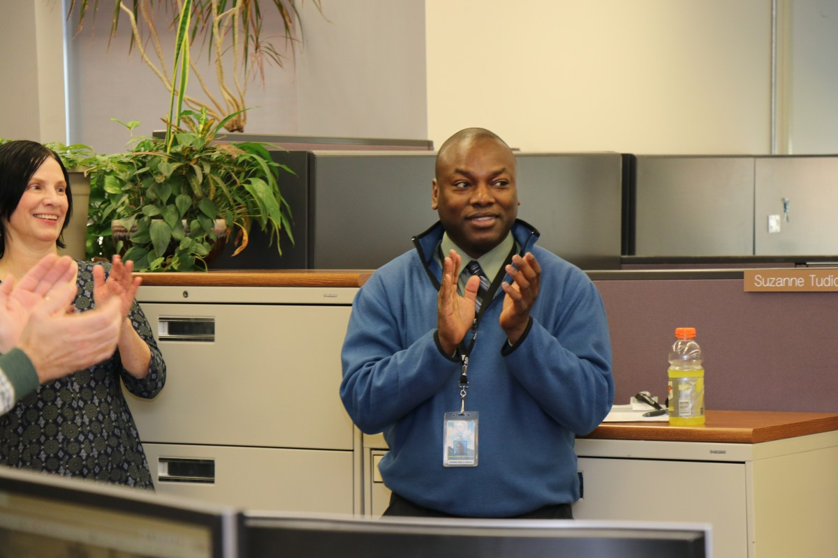 Mr. Rodney Asse, Assistant Superintendent for Finance applauds his team.