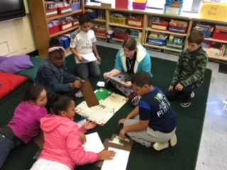 Students in Ms. Hoffman's class share their math games with students from Mrs. St. Clair's class.
