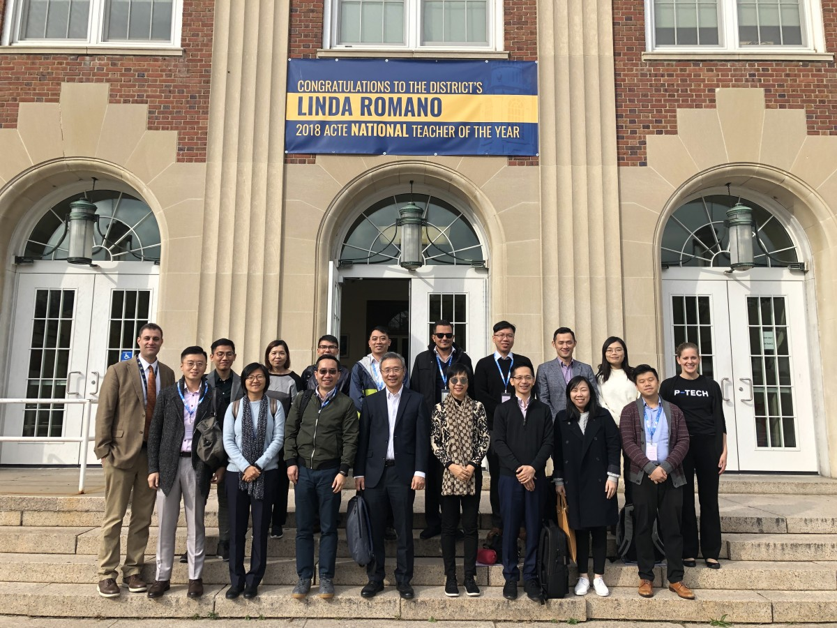 Group from Hong Kong poses in front of the high school.