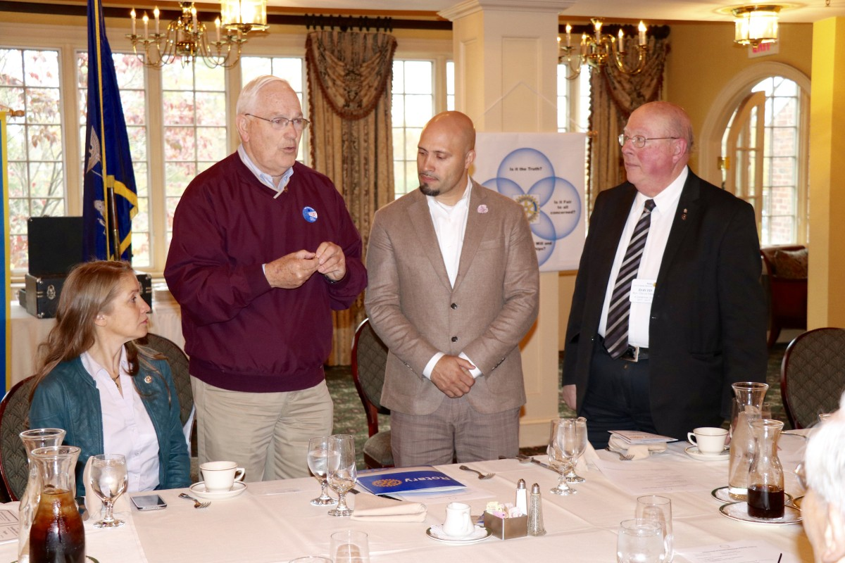 Dr. Padilla stands with members of the Rotary Club during initiation