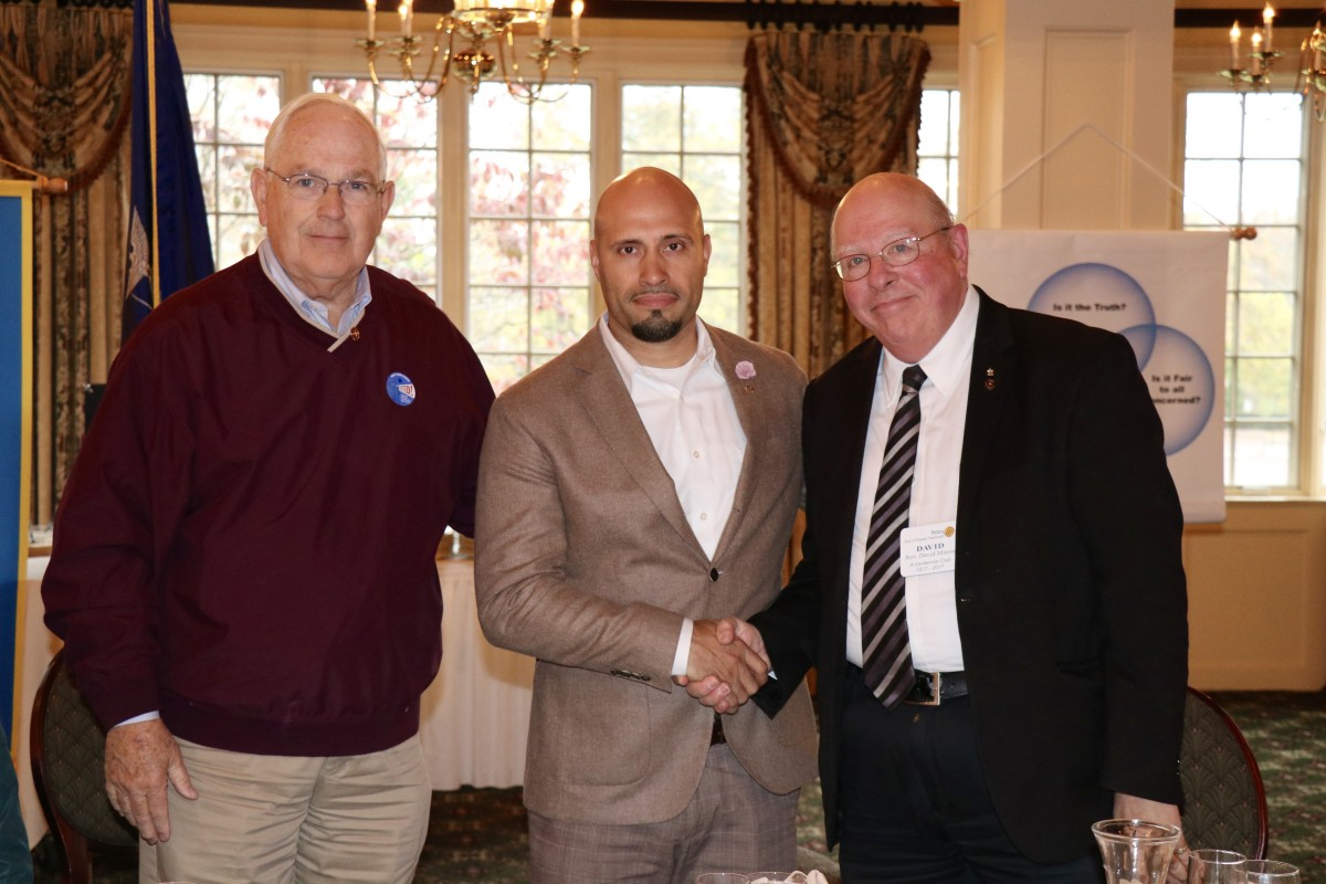 Dr. Padilla stands with members of the Rotary Club after initiation