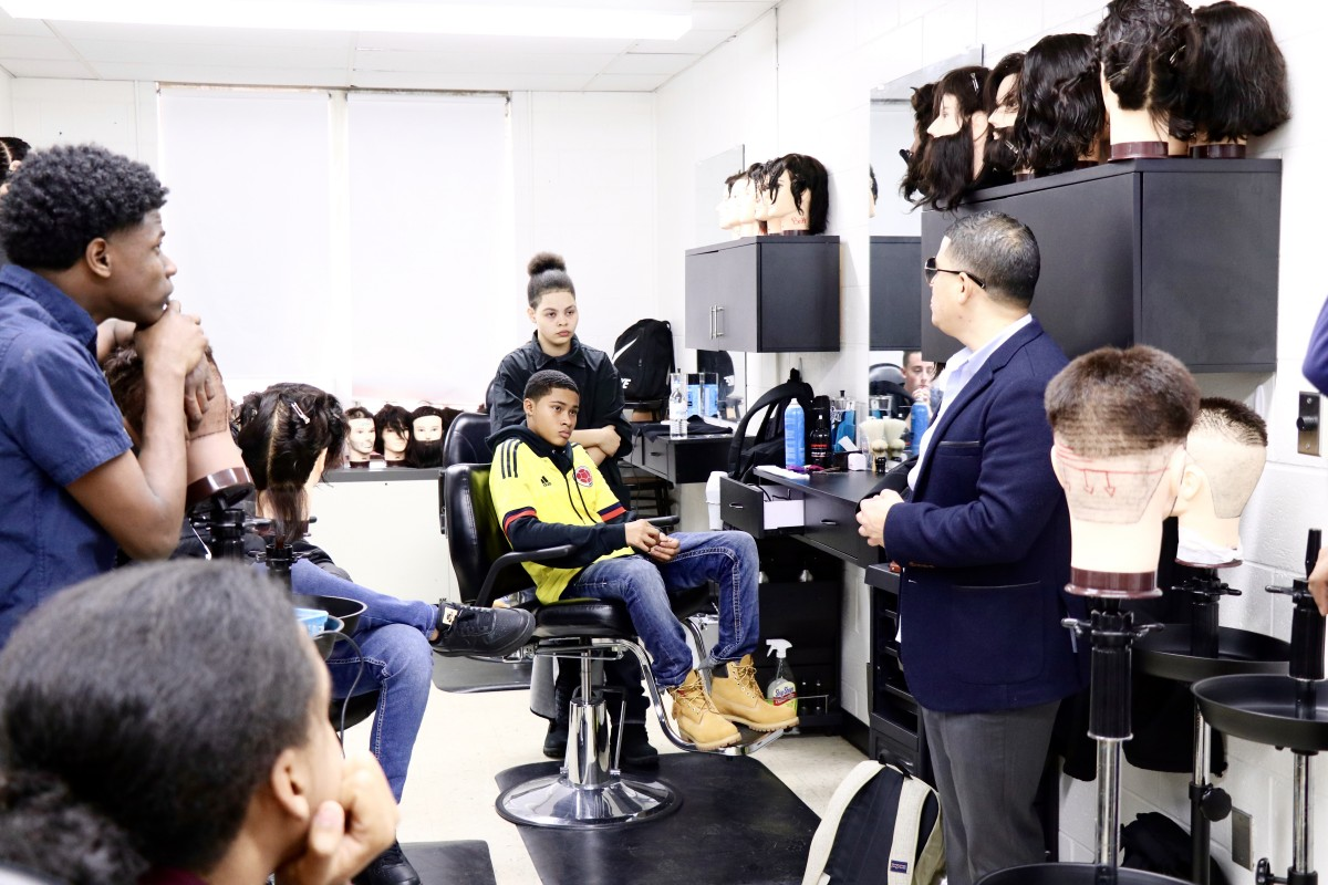 Guest barber presents to barbering students