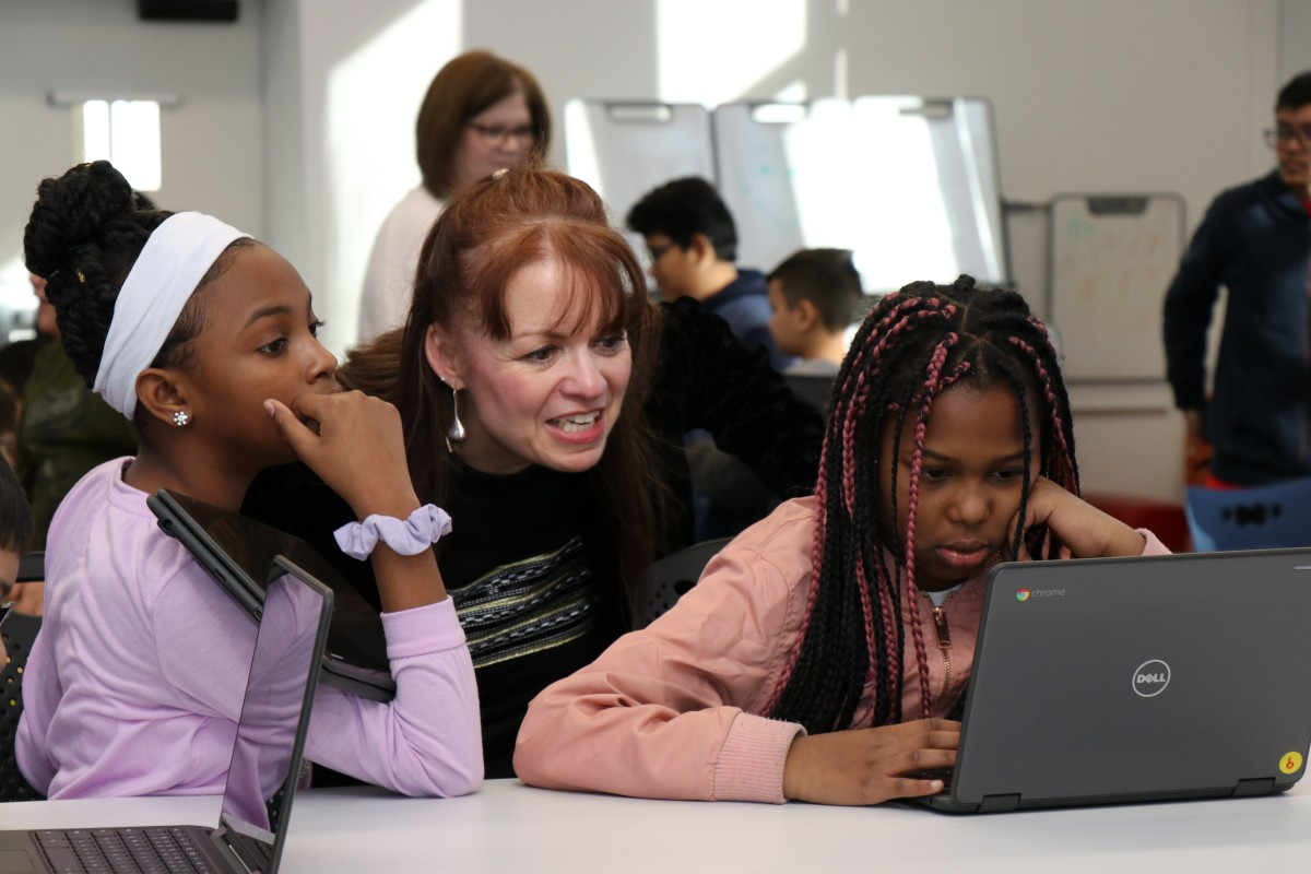 Mrs. Thomas-Cappello works with younger scholars during an Hour of Code event.