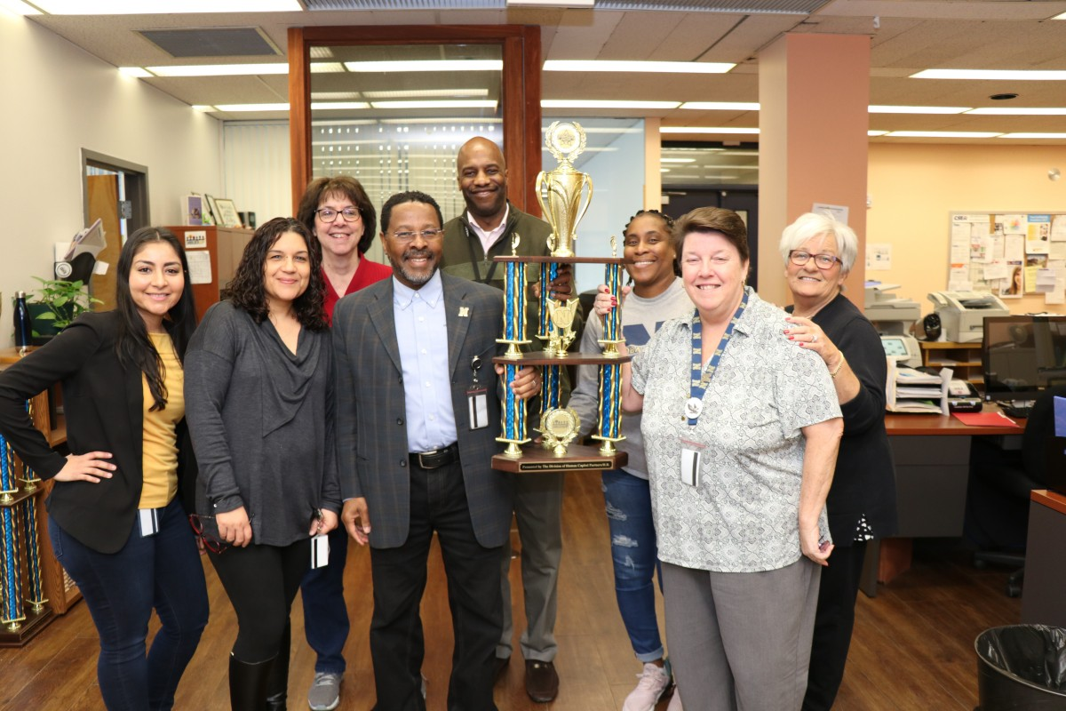 The Human Resources Department poses with their trophy.