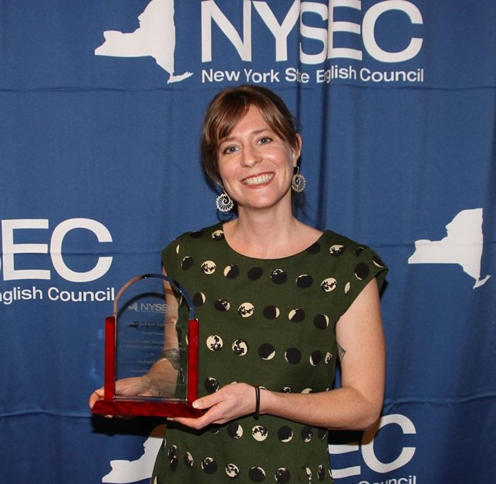 NFA North teacher, Ms. Jackie Hesse poses for a photo while holding her award.