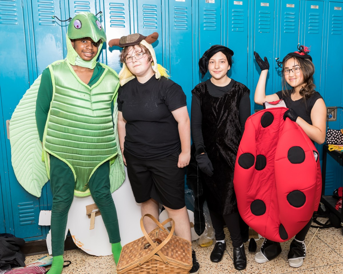 Students pose in costume.