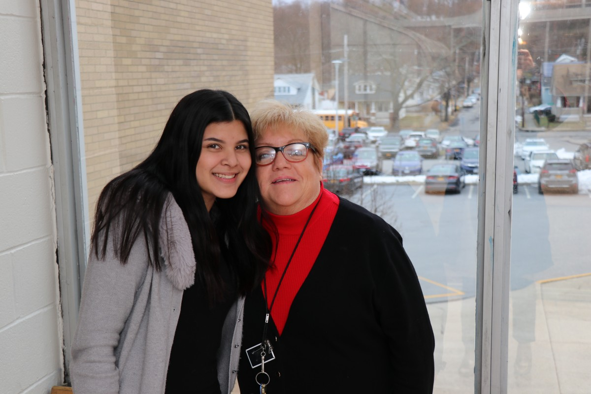 NFA student Kisbell poses for a photo with assistant principal, Ms. Margaret Chesser.
