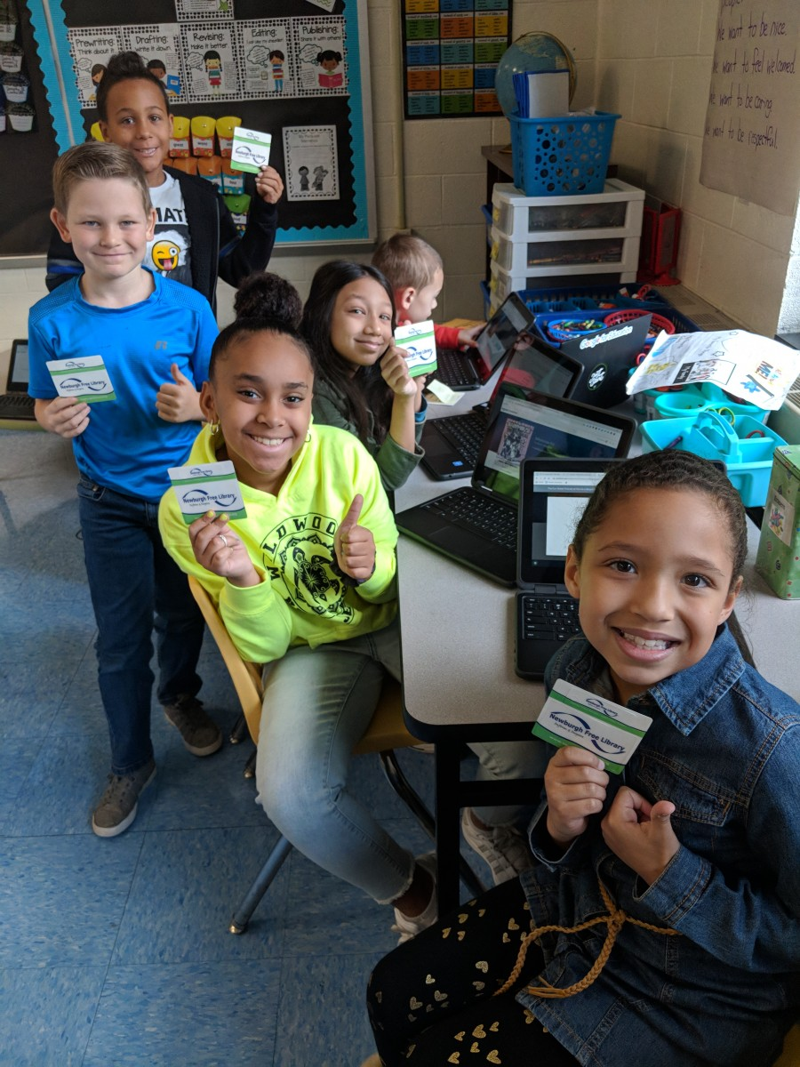 Students with their library cards.
