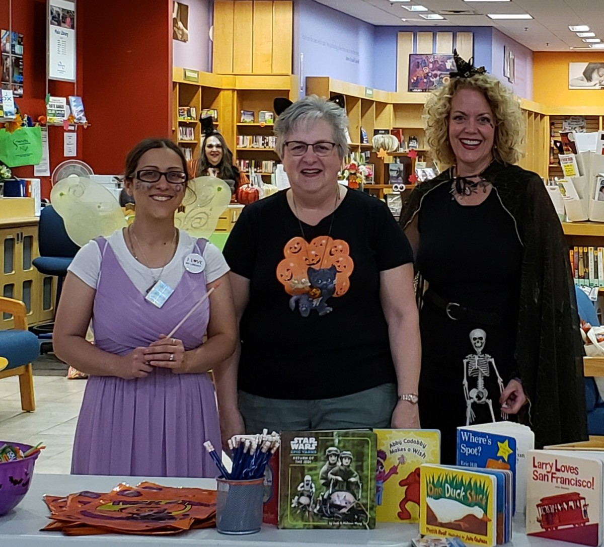 Library staff pose for a photo in their costumes.