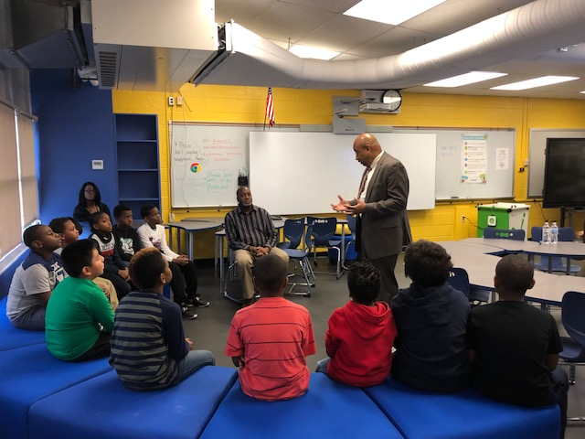 Principal Kafele speaking to scholars at Balmville Elementary School.