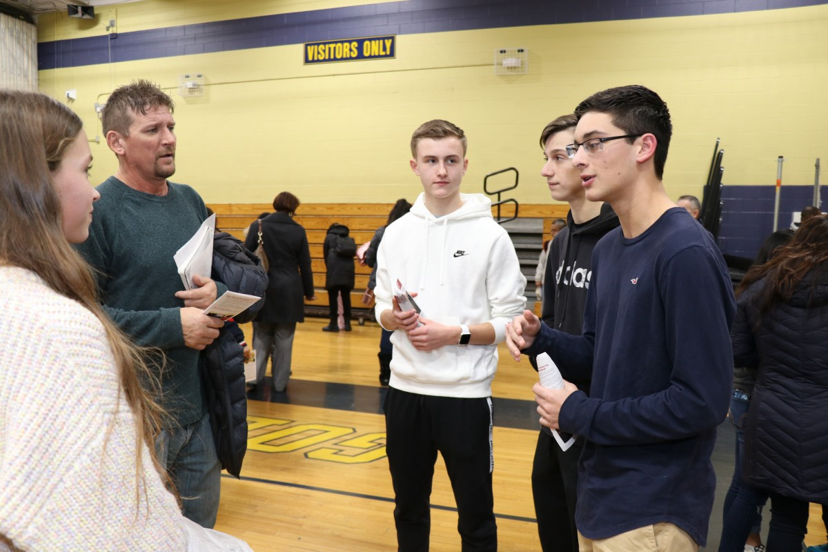 Students talk to students and their families about the program.