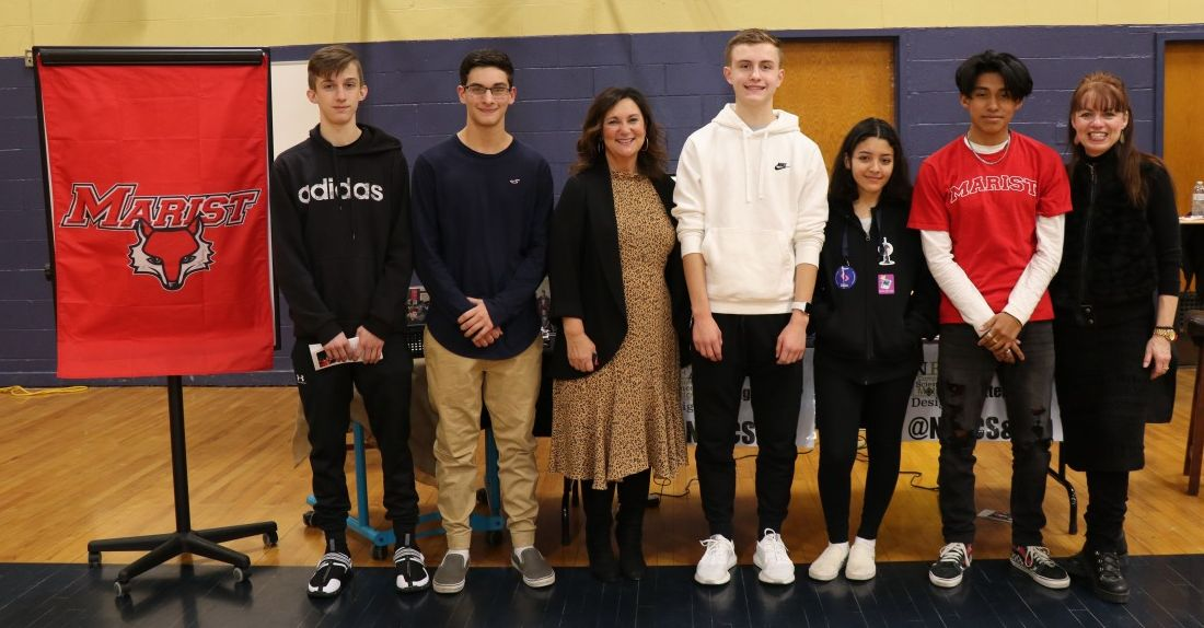 Scholars pose for a  photo with program administrator Ms. Susan Valentino and teacher Ms. Elizabeth Thomas-Cappello