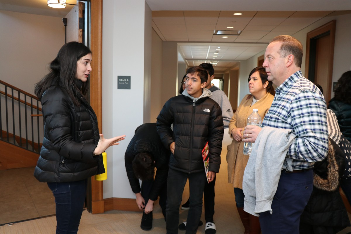 Students and their parents receive a tour of campus.
