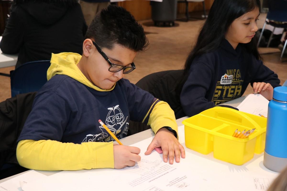 Scholars work on a math problem.