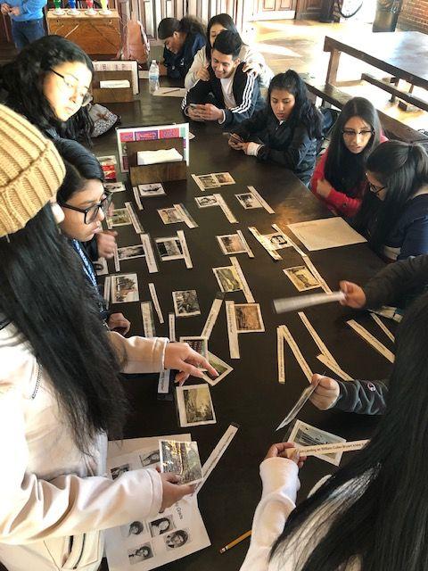 Students look at historic photos.