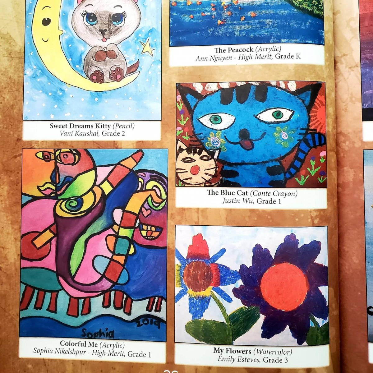 Pages of the book with artwork submitted by Meadow Hill scholars.