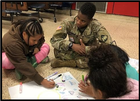 Cadet Alana Chandler directs her group to write down ideas for their goals.
