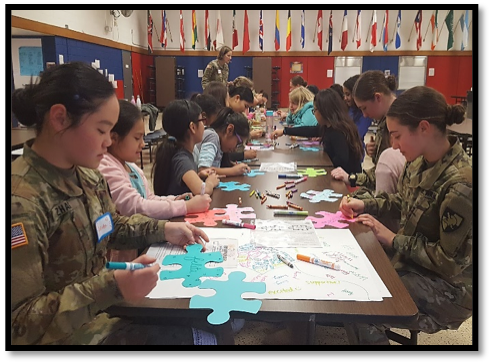 Cadets and the girls of Meadow Hill decorate individual puzzle pieces to take home as a reminder of the lesson.