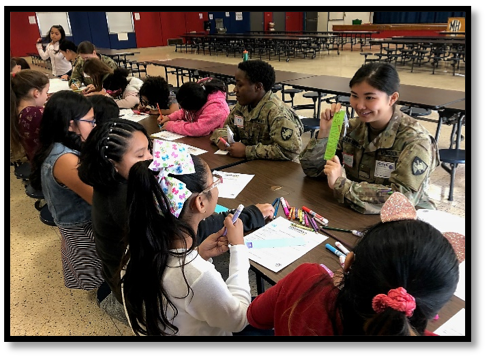 Cadet Anujin Gankhuyag encouraged the girls as they chose words that represented their confidence for their bookmarks.