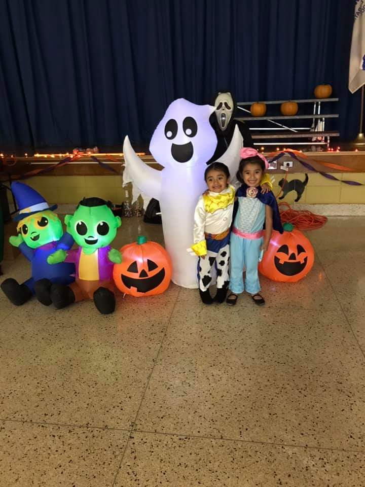 Students pose for a photo in their costumes.