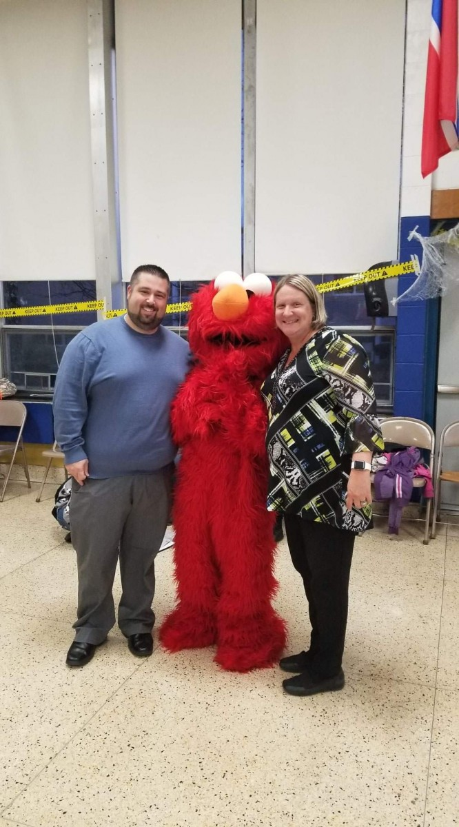 Mr. Prokosch and Ms. Russell pose with Elmo.