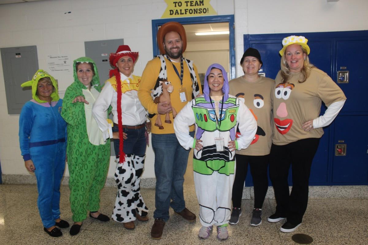 Teachers pose in their Toy Story costumes.
