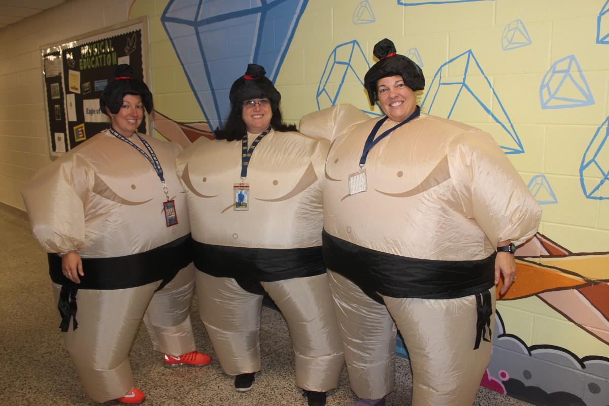 Teachers pose in their Sumo costumes.