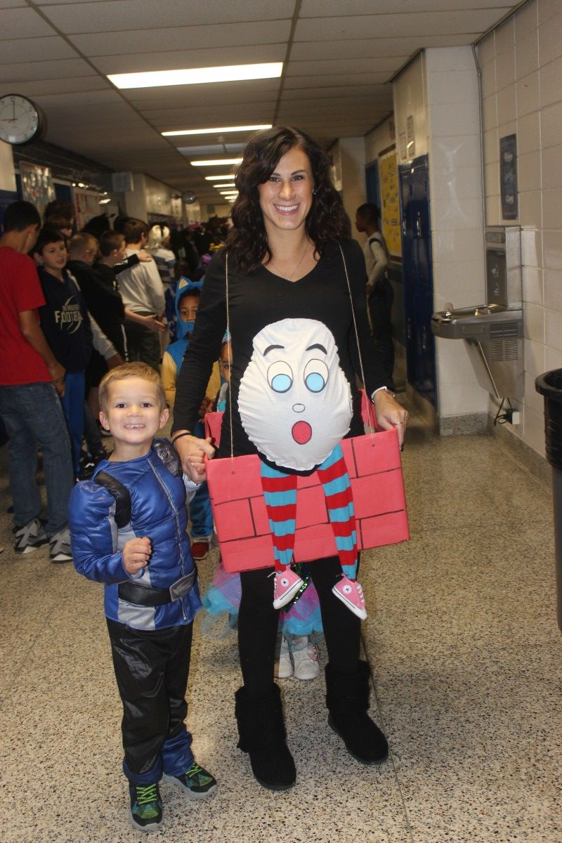 Student and teacher pose in their costumes.