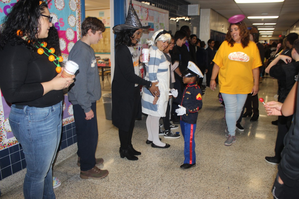 Students participate in hallway Halloween parade.