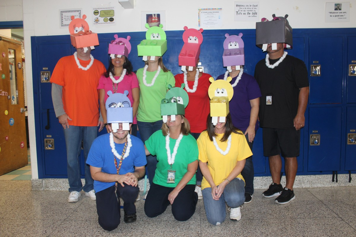 Teachers pose in their Hungry Hungry Hipposcostumes.