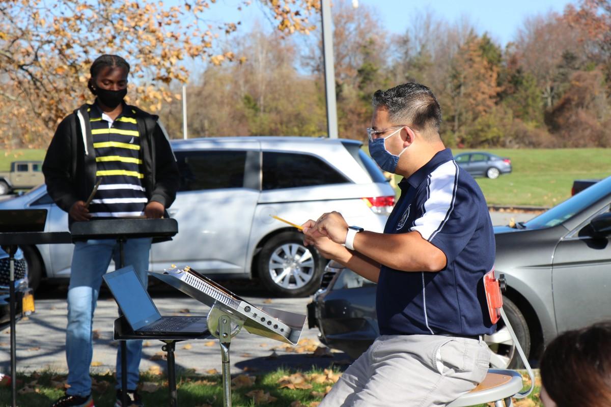 Teacher conducting outside.