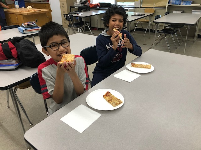 Students enjoying their pizza.