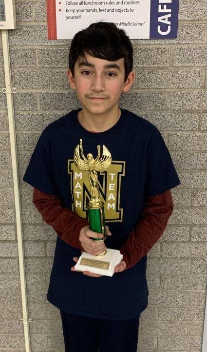 Anakin Lanolfa from Heritage Middle School won an individual award for highest percentage correct (85%) in Section A. He poses for a photo with his trophy.