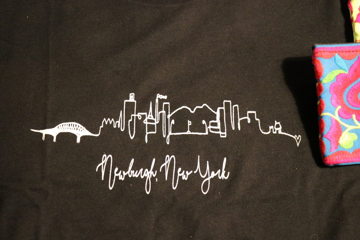 Group designed t-shirt on display.