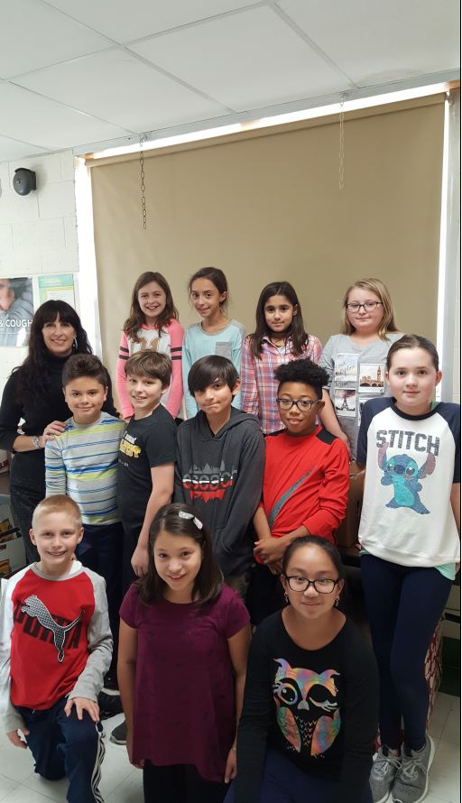 Photo here is Kelly Caci, school psychologist, pictured with New Windsor School Clintonian Society students, who helped by collecting donated food from classrooms each day.