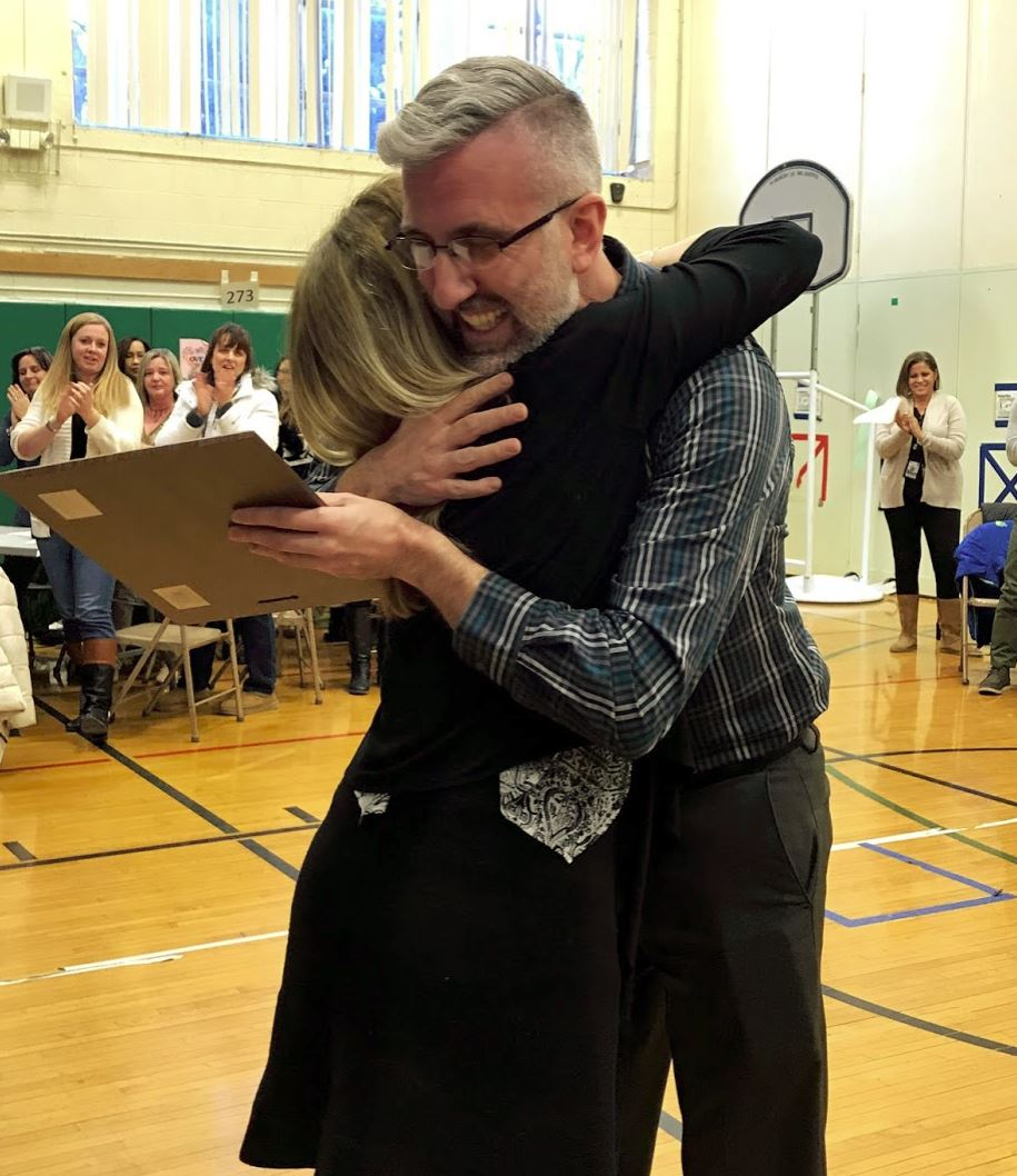 Assistant Principal, Ms. Lamarche hugging Mr. Formato